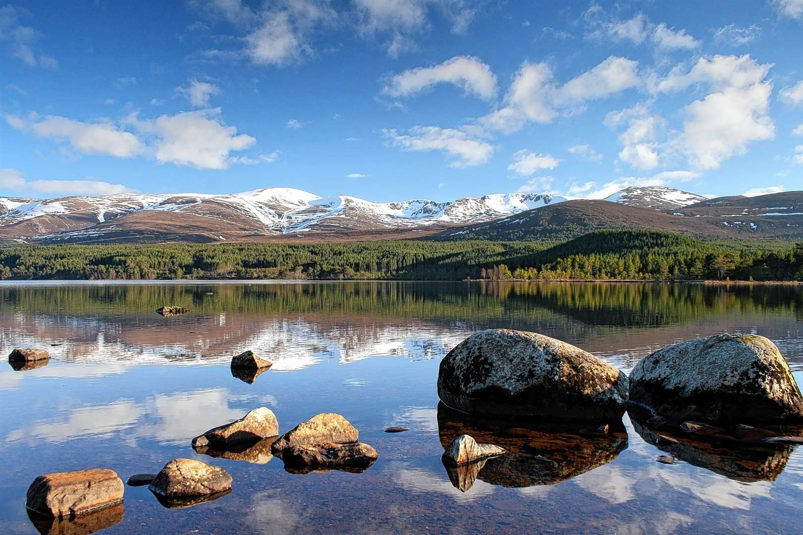 The Cairngorm mountains, as seen from Loch Morlich