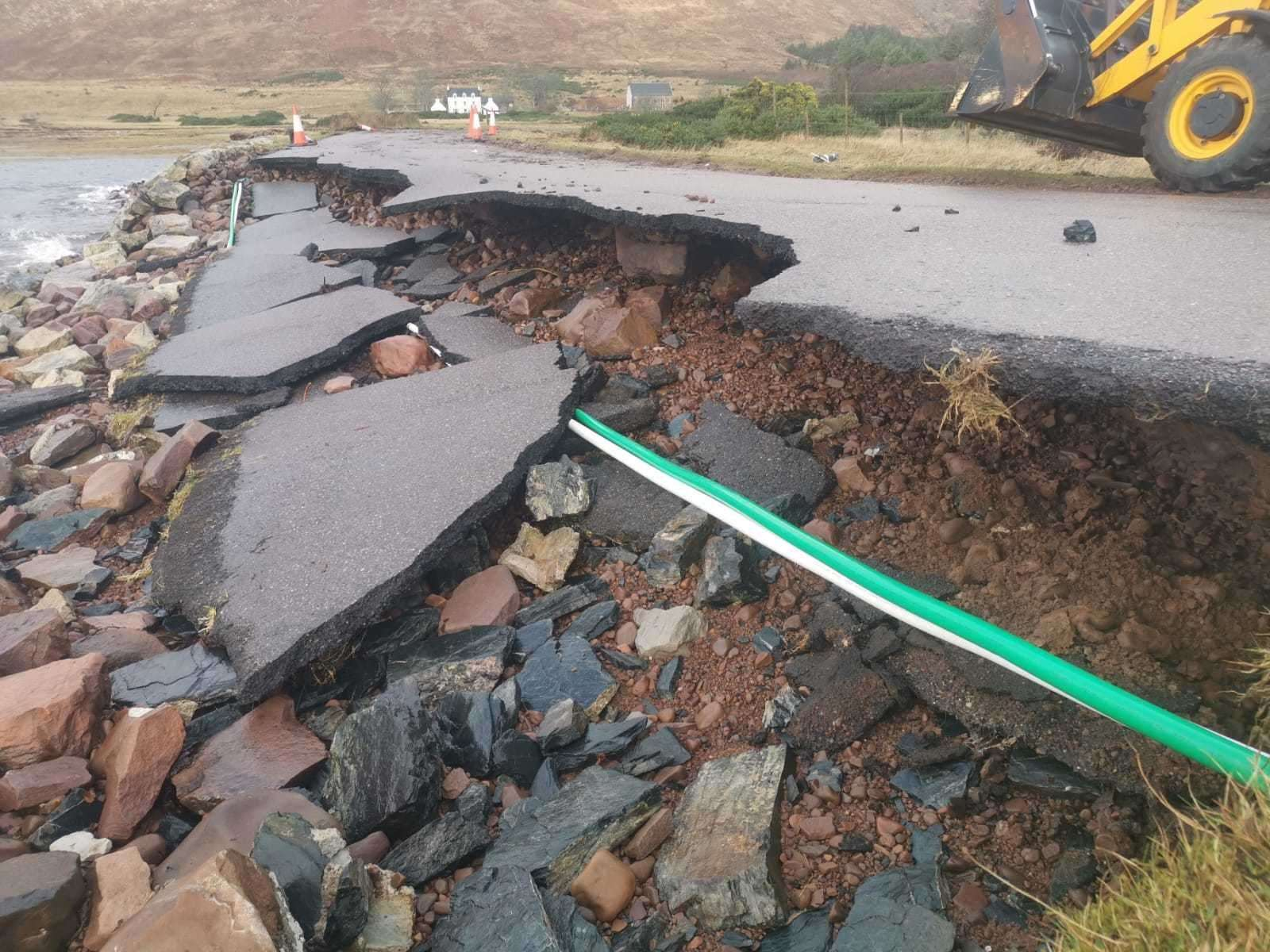 Damage to a road at Applecross caused by Storm Brendan.