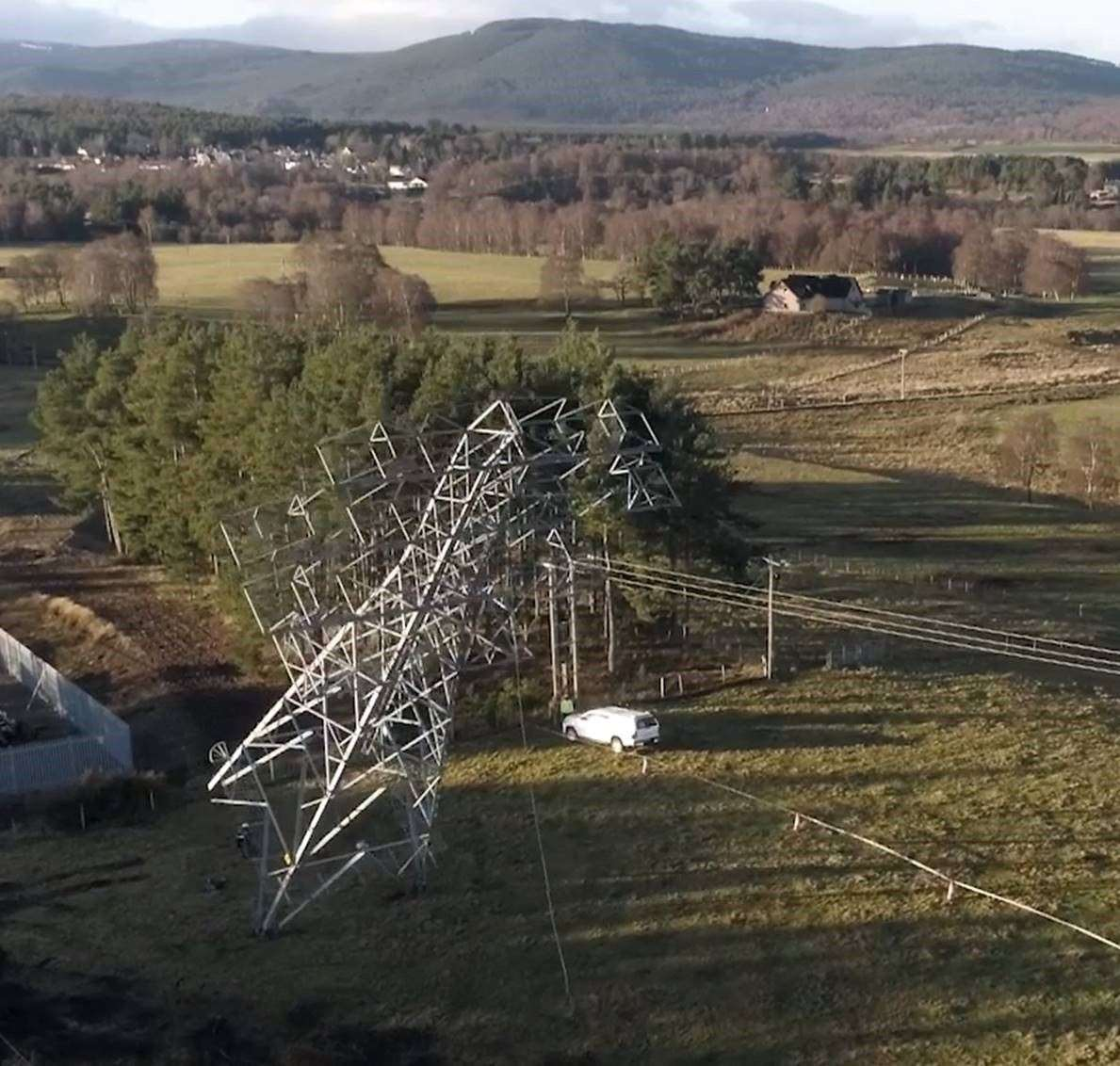 The final pylon comes crashing down to mark the end of the big money project in Strathspey.